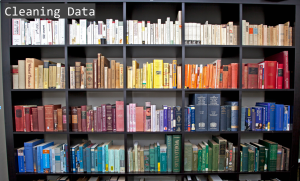 books on a shelf organized by color with 'Cleaning Data ' title